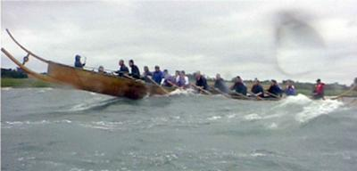 The Iron-age Hjortspring-boat taking a beating.